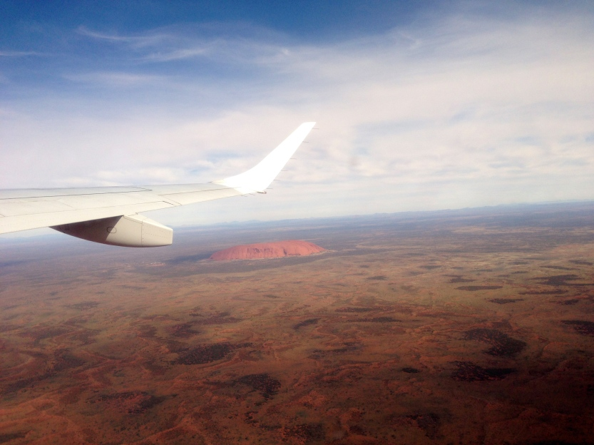 Uluru stands alone in a scorched land
